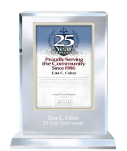 Lisa C. Cohen with an award for 25 years service in the legal community.
